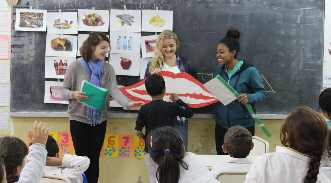 Volunteers in a High School Special in Argentina teach children about dental hygiene.